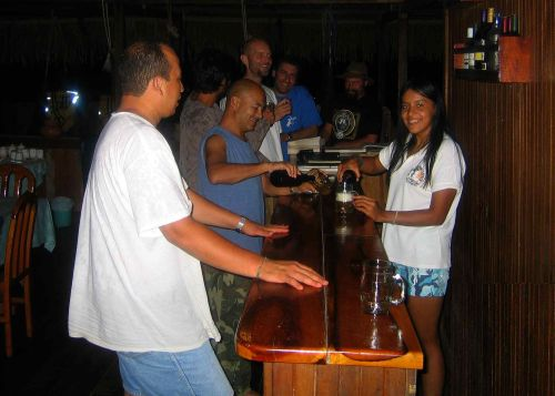 Visiting the Amazon in Ecuador: Enjoying a friendly evening at the Cuyabeno lodge when visiting the Amazon in Ecuador.